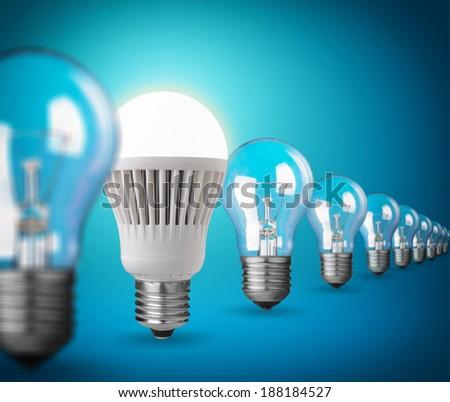 Idea concept with light bulbs on blue - stock photo
