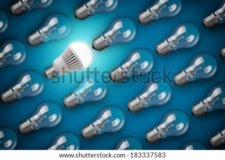 Idea concept with light bulbs on blue background - stock photo