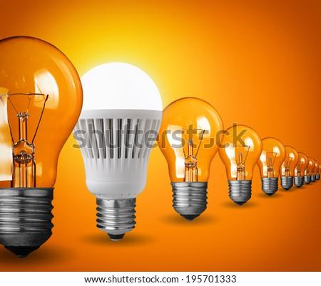 Idea concept with light bulbs on orange background - stock photo