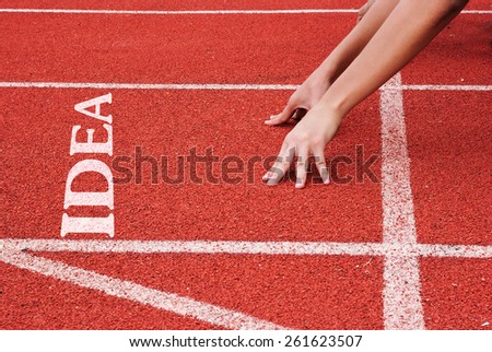 Idea - hands on starting line - stock photo