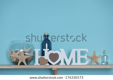 Idea of interior decoration with starfishes, glass bottles and wooden elements - stock photo