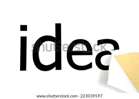 Idea on white background in a paper hole - stock photo