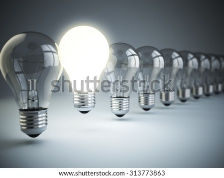 Idea or uniqueness, originality concept. Row of light bulbs with glowing one on blue background, 3d - stock photo