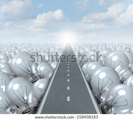 Idea road and creative Path business concept as a street or highway cutting through a landscape of light bulbs as a symbol and metaphor for innovation success and brainstorming solution. - stock photo