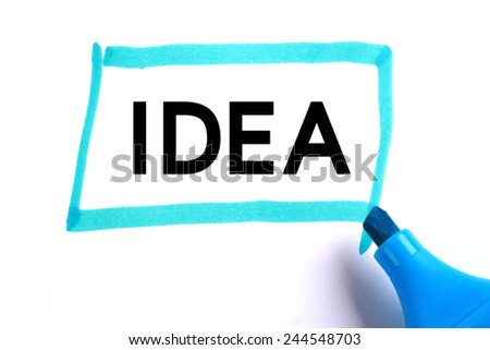Idea word in blue rectangle with blue marker on white paper. - stock photo