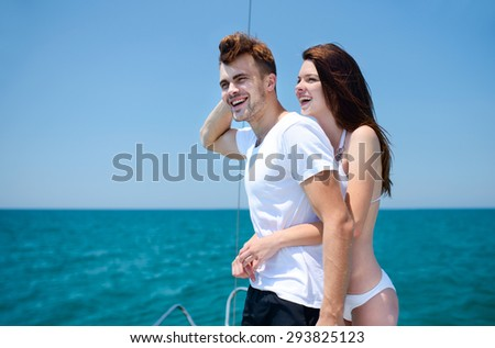 Ideal beauty young couple on sailing yacht - stock photo