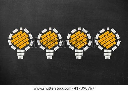 Ideas Light Bulb Concept Work on Blackboard. Bulbs set figures of the children's designer - stock photo