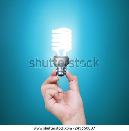 Ideas light bulb in the hand - stock photo