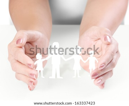 ideas, paper family in the hand  - stock photo