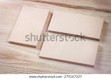Identity Design, Kraft Paper Corporate Business Card on aged wooden background - stock photo