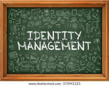 Identity Management - Hand Drawn on Chalkboard. Identity Management with Doodle Icons Around. - stock photo