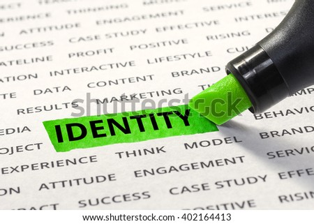 Identity message highlighted with marker on paper of other related words. For direction of business strategy success concept - stock photo