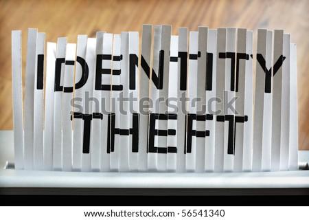 Identity theft concept, shredding personal information - stock photo