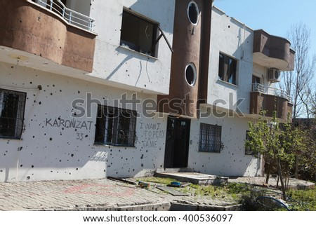 IDIL, SIRNAK - MARCH 31: A building is seen just after it was hit during clashes between Kurdish protesters and Turkish police. The Photo Taken March 31, 2016.  - stock photo