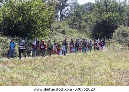 Idomeni, Greece - August 19 , 2015: Hundreds of immigrants are in a wait at the border between Greece and FYROM waiting for the right time to continue their journey from unguarded passages - stock photo