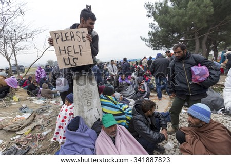 Idomeni, Kilkis, Greece, November 21 2015: Refugees and migrants stage a protest demanding to be allowed to cross to Macedonia, near the Greek village of Idomeni. - stock photo