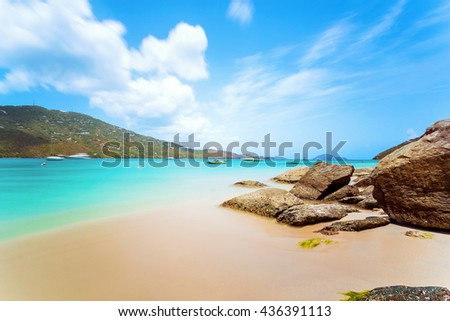 Idyllic beach at Magens Bay, Saint Thomas, US Virgin Islands. This beach is considered one of the best top ten beaches in the world. Paradise and clear water for relaxation. Idyllic spot. - stock photo