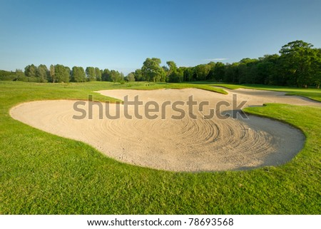 Idyllic golf course with sand banks - stock photo