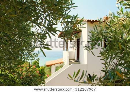 Idyllic Greek house, villa, by the sea , between olive trees, Greece, holiday, Sithonia, vacation, panoramic view, beautiful Mediterranean landscape - stock photo
