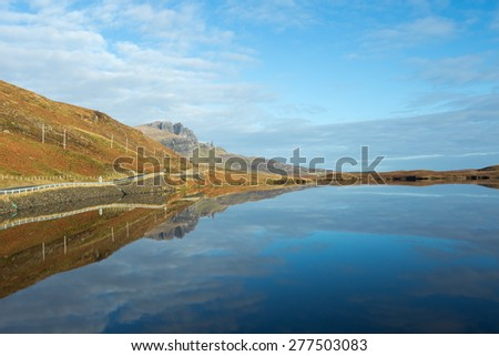 Idyllic landscape of loch infront of the old man of Storr in the Isle of Skye, Scottish Highlands, Scotland.  - stock photo