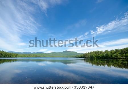 Idyllic Mountain Lake on Sunny Summer Day - Lake Chocorua in New Hampshire - stock photo