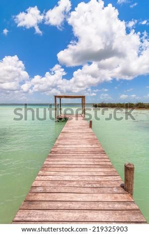 idyllic pier in Caribbean Bacalar lagoon, Quintana Roo - Mexico. - stock photo