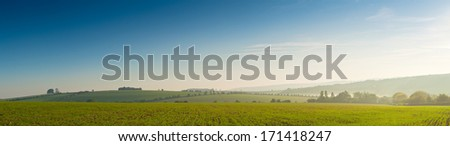 Idyllic rural view of pretty farmland and healthy livestock, in the beautiful surroundings of the Cotswolds, England, UK. - stock photo