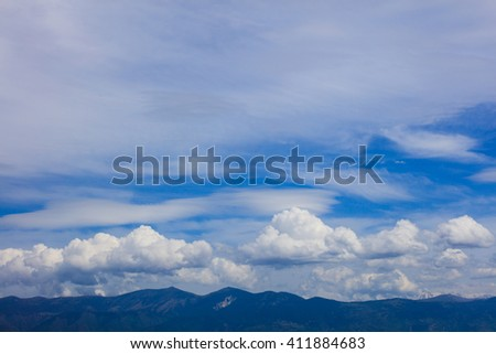 Idyllic scene of skyscape over land in daylight - stock photo