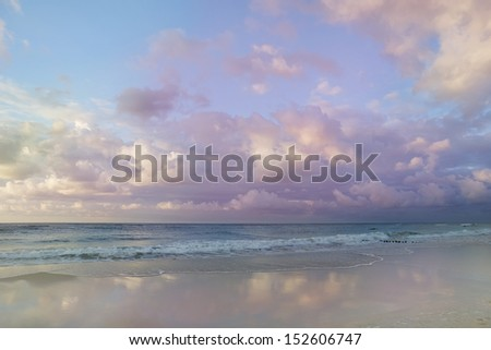 idyllic sea landscape - pastel shades clouds and water - stock photo