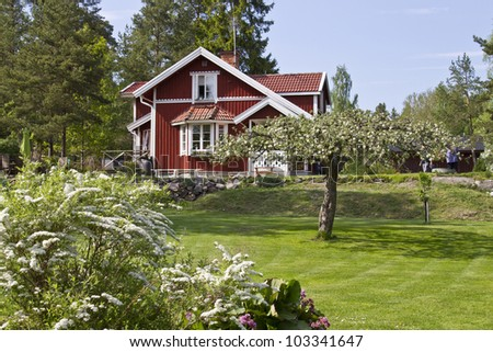 Idyllic summer house in Sweden. - stock photo