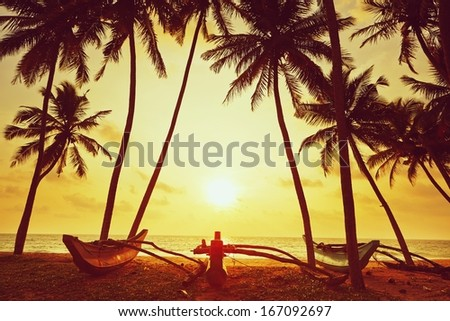 Idyllic sunset on the beach near Hikkaduwa in Sri Lanka  - stock photo
