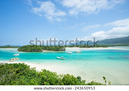 Idyllic tropical lagoon full of clear turquoise water and perfect white sand paradise beach on Ishigaki island, Okinawa, Japan - stock photo