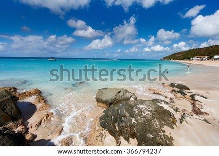 Idyllic tropical Turners beach at Antigua island in Caribbean with white sand, turquoise ocean water and blue sky - stock photo