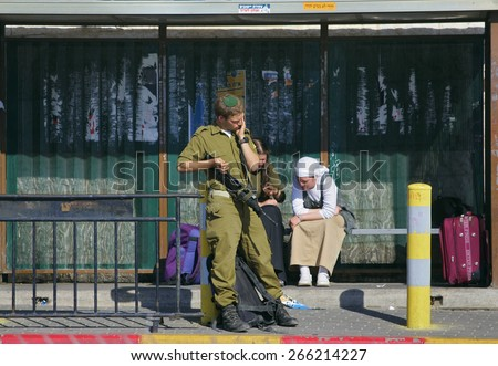 Ierusalim, Israel - April 29, 2005: Israel Defense Forces soldiers standing at a bus stop on April 29, 2005, Ierusalim, Israel. - stock photo