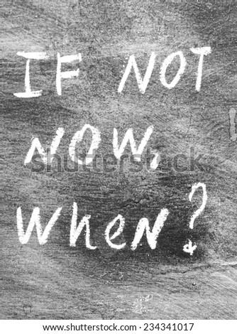 If not now, when? - handwritten on a blackboard - stock photo