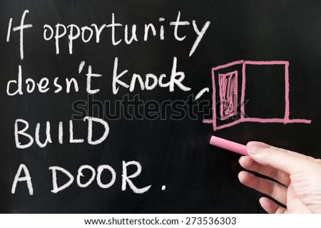 If opportunity doesn't knock, build a door words written on blackboard using chalk - stock photo