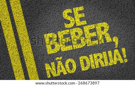 If you Drink, Don't Drive (in Portuguese) written on the road - stock photo