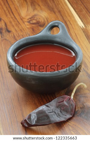 If you're looking for a great hot sauce, then this is the hot sauce for you.  Delicious fermented hot chili sauce, made with red hot peppers, garlic and unrefined sea salt. Simple to make. - stock photo