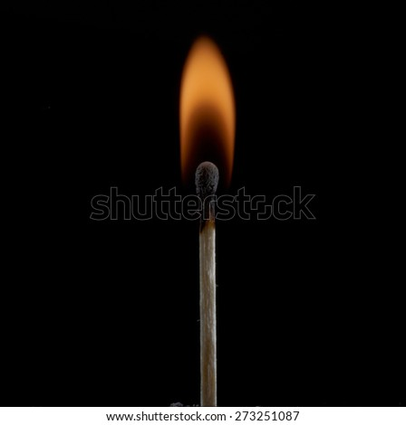 Ignition of a match on dark background - stock photo