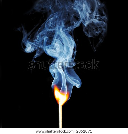 Ignition of match, with smoke on black - stock photo