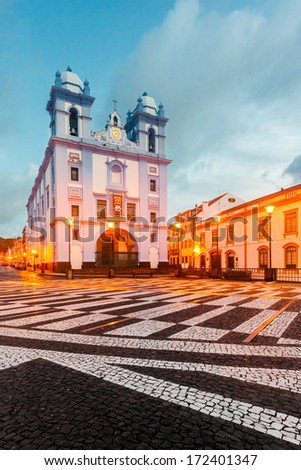 Igreja da Misericordia, blue church in old city. Old city is UNESCO heritage. Soft colors and bright lights. Early morning after storm. Angra do Heroismo, Terceira island, Azores islands. - stock photo