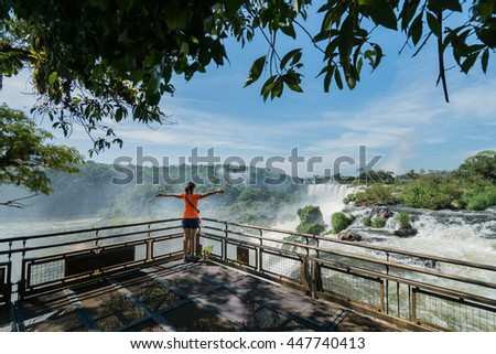 Iguazu Falls, Adventure traveler enjoy stunning view of  New 7 Wonder of the world - Argentina - stock photo