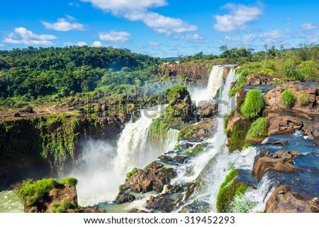Iguazu Falls, on the border of Argentina, Brazil, and Paraguay. - stock photo