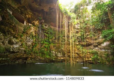 Ik-Kil Cenote near Chichen Itza in Mexico - stock photo