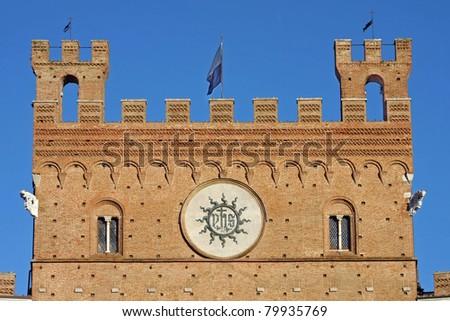 Il palazzo pubblico in the piazza del campo, Siena - details - stock photo
