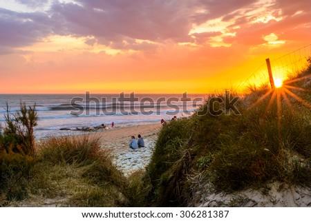 Ile d'Oleron,France 3 August 2015: People on the beach at sunset on Ile d Oleron, Charente Maritime - stock photo