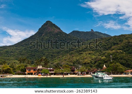 ILHA GRANDE, BRAZIL - OCTOBER 14, 2013: Vila do Abraao town view from the sea with beautiful landscape. Located in Ilha Grande island near Rio de Janeiro, it is a perfect getaway from busy city life. - stock photo