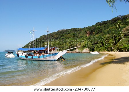 Ilha Grande: Sailboat at beach Praia Lopes Mendes, Rio de Janeiro state, Brazil - stock photo