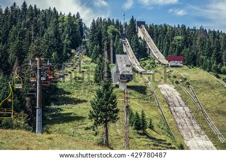 Ilidza, Bosnia and Herzegovina - August 24, 2015. Abandoned Olympic Jumps on the mountain of Igman in Ilidza. The Objects was built for Winter Olympic Games in 1984 - stock photo
