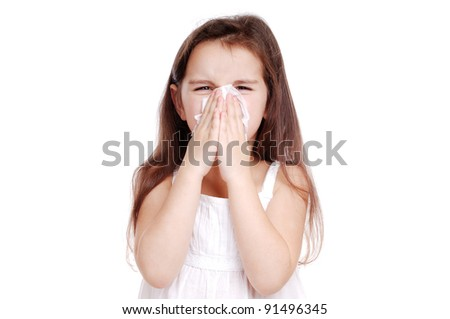 Ill child blowing her nose - stock photo